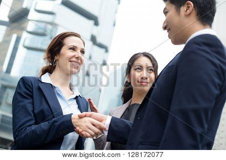 Business people hand shake