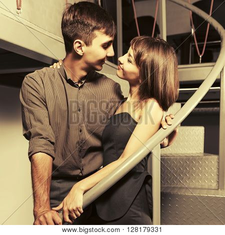 Happy young couple flirting at apartment. Male and female fashion model. Man and woman indoors