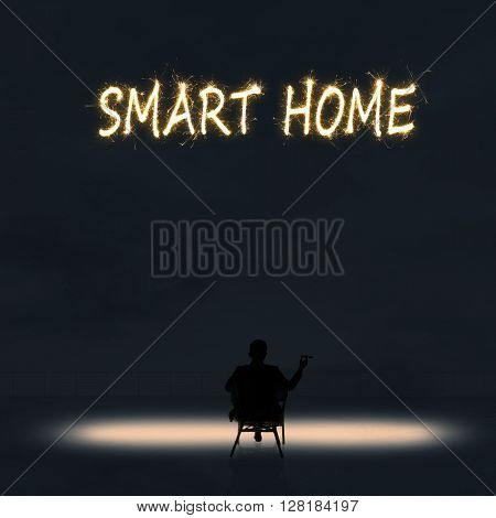 Concept of smart home with a person stand in the outdoor and looking up the text over the sky in the night.