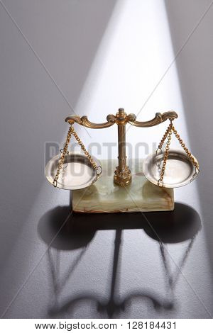 Law scales on gray background. Symbol of justice