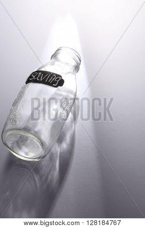 empty saving jar with label saving