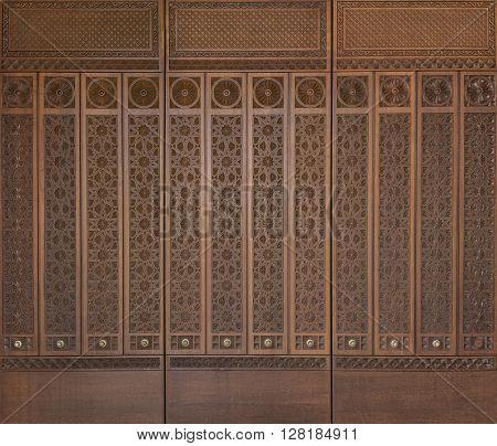 An elegant  middle eastern design engraved on wood.