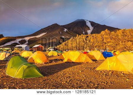 Magic Dawn National Park Landmannalaugar, Iceland. Tents tourists, mountains and glaciers covered the hot morning sun