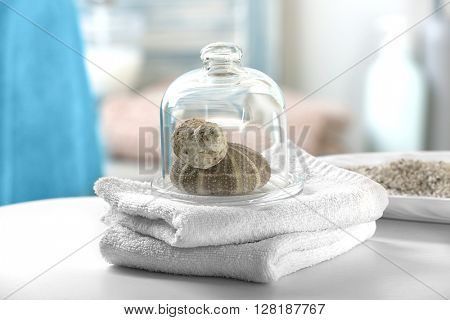 White towels with shells on bathroom table