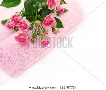 Spa concept. Flower bouquet and towel isolated on white background