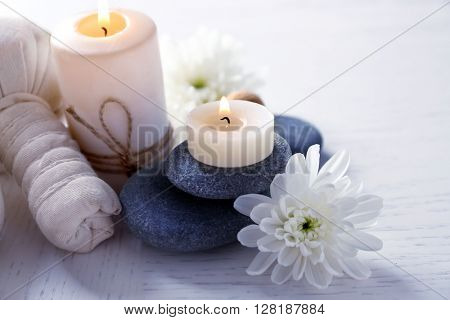 Beautiful composition of spa treatment on a white wooden table