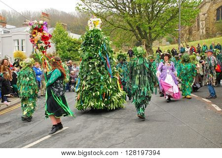 HASTINGS, ENGLAND - MAY 2, 2016: Costumed people parade through the Old Town during the annual Jack In The Green festival. The traditional event marks the May Day public holiday in Britain.