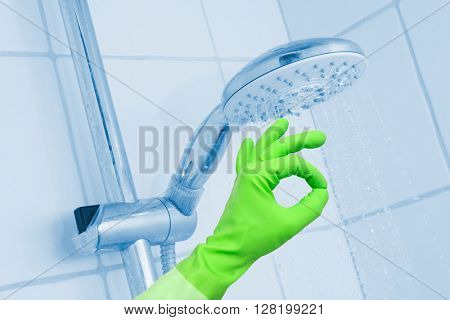 Cleaning shower with glove on