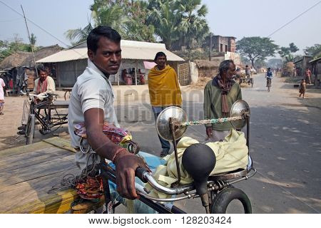 BARUIPUR, INDIA - JANUARY 14: Rickshaw driver waits for the next customer on January 14, 2009 in Baruipur, West Bengal, India.