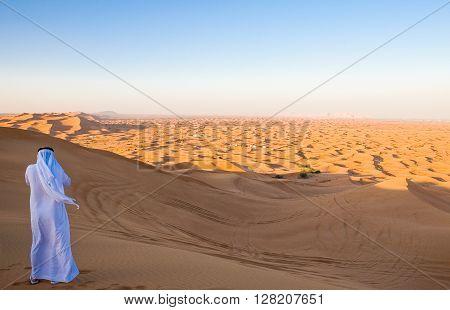 Dubai a man in traditional dress in the Al Dhana desertic area