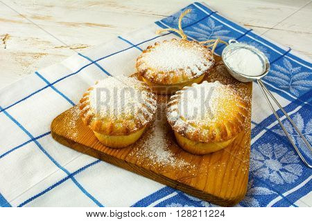 Small confiture pies and baking sieve. Jam pie. Small pie. Pie. Sweet pastry. Sweet dessert