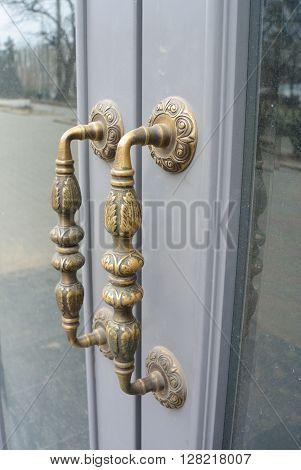 old bronze metal handles with glazing door poster