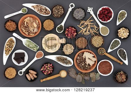 Healthy food selection used for womans health over grey background.