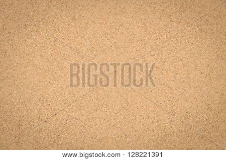close up nature background of sand pattern of a beach in the summer