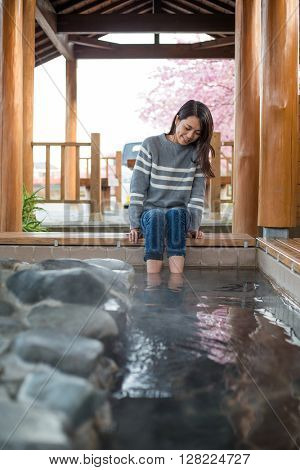 Woman enjoy foot hotsprings