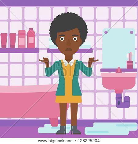 Woman in despair standing near leaking sink.