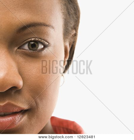 Close up portrait of African American woman against white background.