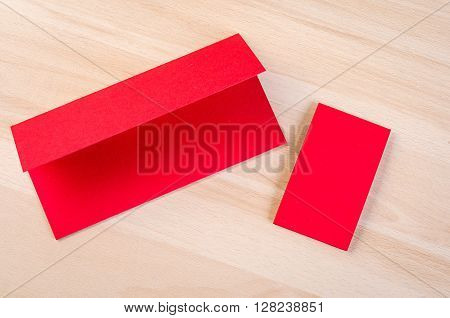 Small pieces of red paper and cardboard