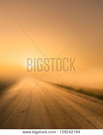 The sun rises over heavy fog
