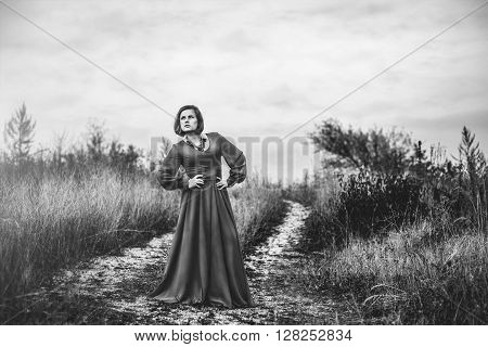 Portrait of young woman in long blue dress