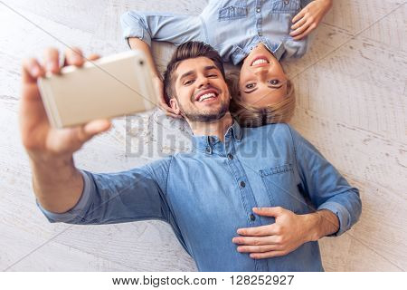 Beautiful Couple At Home With Gadget