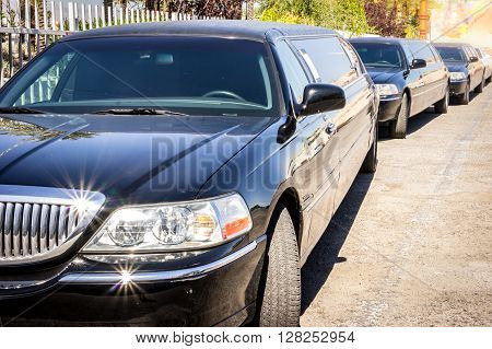 Three Black Limousines In A Row.