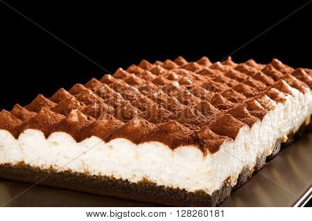 Delicious tiramisu dessert isolated. Traditional italian sweet dessert.