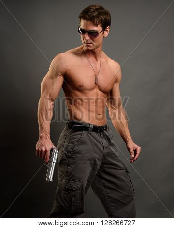 The hot secret agent is holding a pistol.