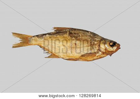 Smoked fish bream. Isolated on a gray background.