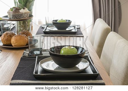 Table Set On Wooden Dinning Table In Modern Dinning Room