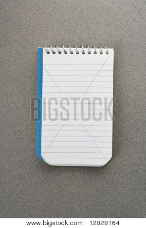 Open spiral bound notepad.