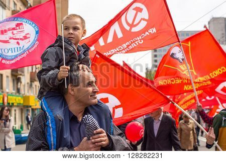MOSCOW, RUSSIA - MAY 1, 2016: Unidentified Communist party supporters together with National Bolsheviks take part in a rally marking the May Day in the  center of Moscow.