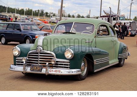 FORSSA FINLAND - AUGUST 2 2015: Classic car Pontiac of two tone green color on the public event of Pick-Nick Car Show.