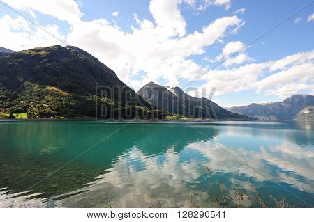 General view of Hjelle fjord, Norway showing the reflection in the water poster