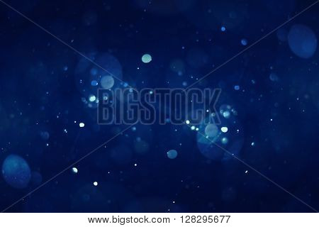 abstract blue bokeh background, faded blue shiny lights