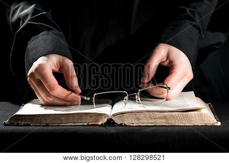 Priest Above The Book