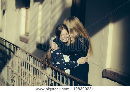 Teen Sisters On Balcony