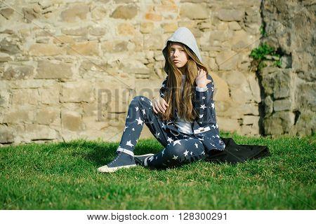 Teen Girl Near Stone Wall