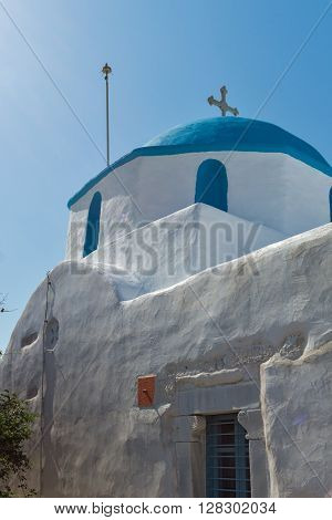 Amazing view of White chuch with blue roof in town of Parakia, Paros island, Cyclades, Greece