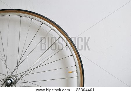 Very light bicucle wheel on white wall