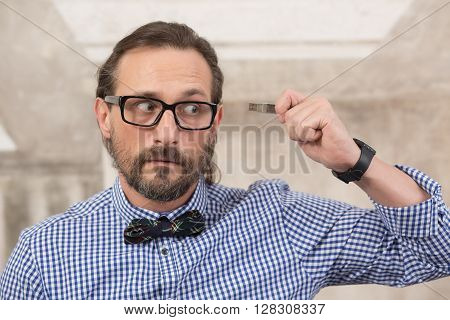 Storage, data, memory concepts. Businessman holding usb flash card demonstrating about problems with memory.