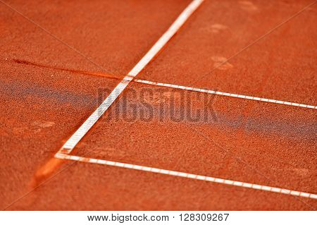Detail with a baseline footprint on a tennis clay court