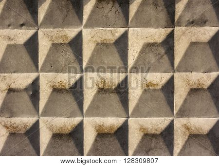 cracked concrete slab with rhombus texture. Grunge background.