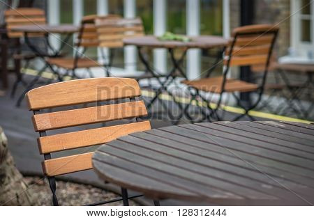 Empty table outside local café in London