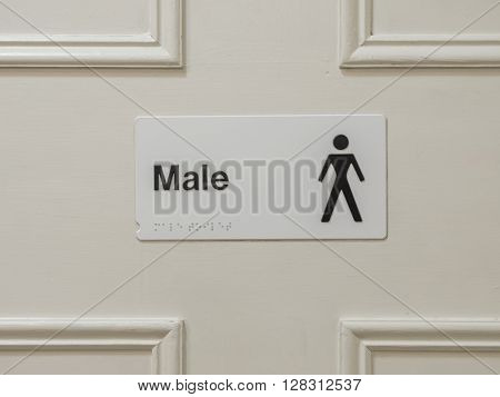 Male toilet sign on the door in a hotel
