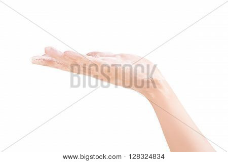 Beautiful female hand in white soap suds isolated on white with clipping path