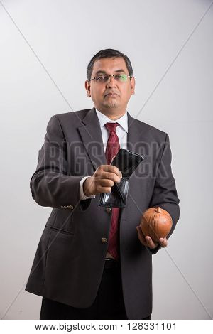indian businessman with empty purse, asian businessman with no money in purse for saving, businessman showing empty money purse over white background, indian businessman and bankruptcy concept