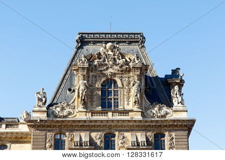 Color DSLR stock image of architectural details on an old building in Paris, France.  Horizontal with copy space for text