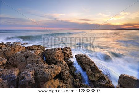 The sun sets at Bherwere Beach in Jervis Bay Territory ACT - Bherwere is the longest highest energy beach on the south coast and has up to 30 rips and waves averaging 1.6m. Long exposure with soft flowing movement in the waves