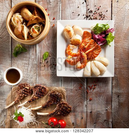Various Main Course on Wood Background